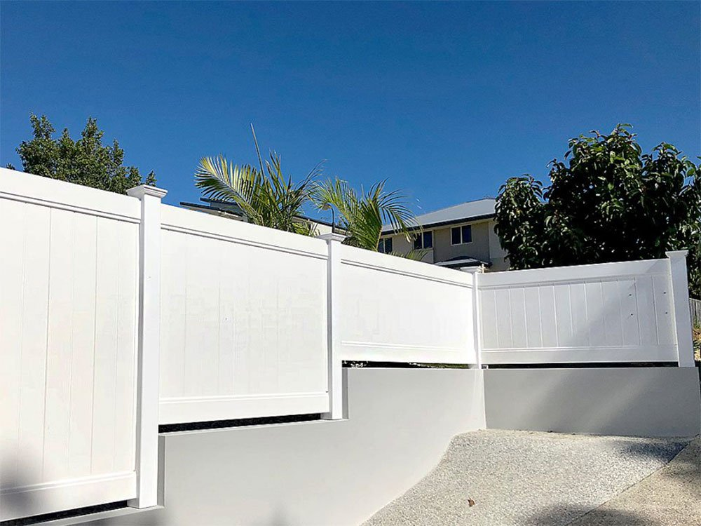 Custom Privacy Fence attached to retaining wall